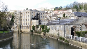 Mill buildings along river