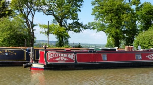 Narrow boat moored with countryside in the distance